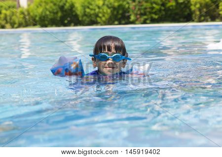 Happy Boy In The Swimming Pool