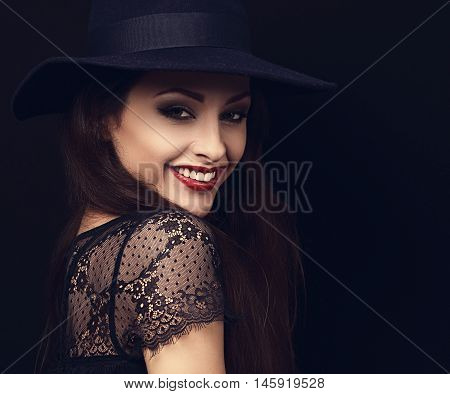 Happy Makeup Woman In Fashion Blue Hat Smiling Toothy On Dark Black Background. Closeup Portrait