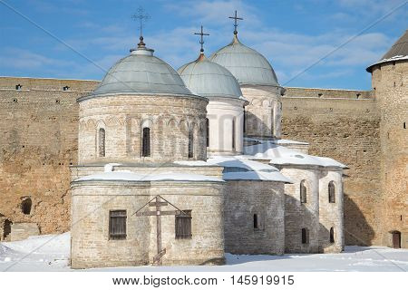 Two medieval churches of Ivangorod fortress closeup, sunny march afternoon. Leningrad region