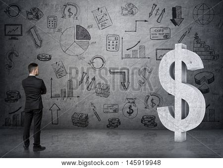 Back view of a businessman looking at big 3D concrete dollar sign. Economy and finance. Money and profit. Successful lifestyle.