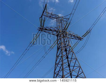 Power Line. pylon against a blue sky