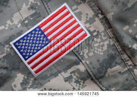 US flag patch on solder's camouflage uniform