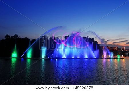 VINNYTSIA, UKRAINE - JUNE 30, 2012: Biggest fountain on the river in Vinnytsia, Ukraine. Located in the river Southern Buh fountain has a length of 140 meters and the height of the jet up to 60 m
