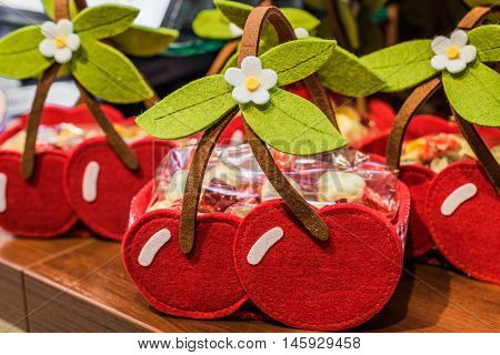 baskets similar to cherries are made of cloth on the table