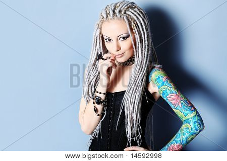 Portrait of a stylish young woman with white dreadlocks. Fashion.