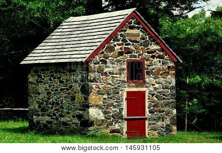 Chadds Ford Pennsylvania - June 9 2015: Stone utility farm building at the 18th century Gideon Gilpin House in Battle of Brandywine National Historic Park