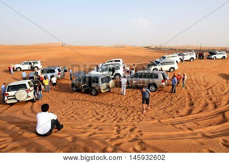 DUBAI UAE - SEPTEMBER 12: The Dubai desert trip in off-road car is major tourists attraction in Dubai on September 12 2013 in Dubai UAE