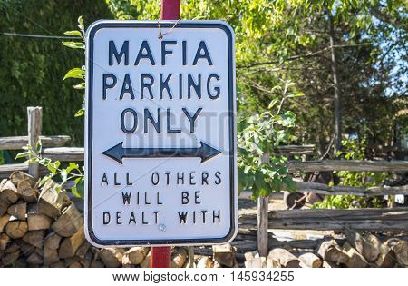 Humorous Parking Sign in Front of a Restaurant
