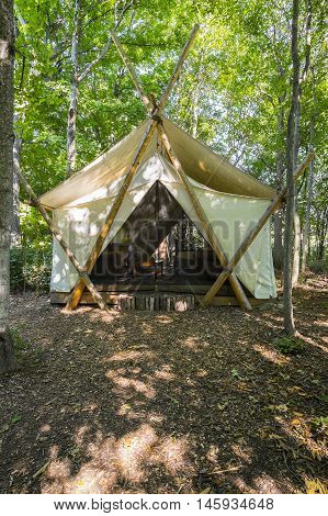 Luxury Camping Tent Made with White Canvas and Cedar Post in the Woods