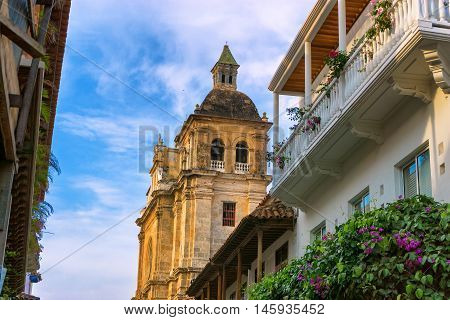 View of historic San Claver church in colonial balconies in Cartagena Colombia