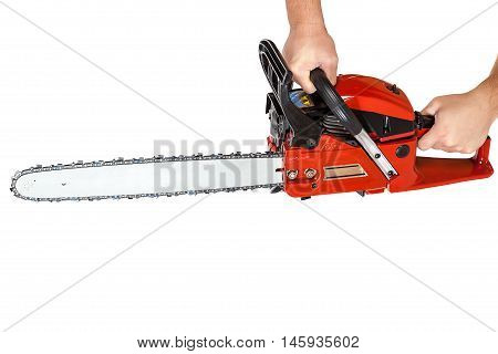 Gasoline chain saw in hand isolated on a white background.