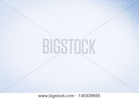 Full frame pale blue mottled background in horizontal 3:2 format.