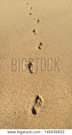 Human footprints in the sand natural background