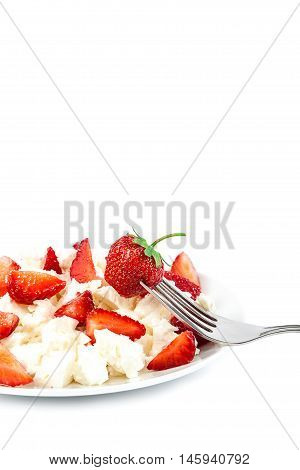 Fresh strawberries with cottage cheese and metal fork isolated on a white background.