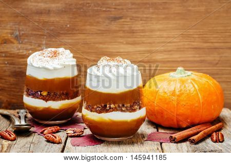 pumpkin butter Greek yogurt parfait on wooden background