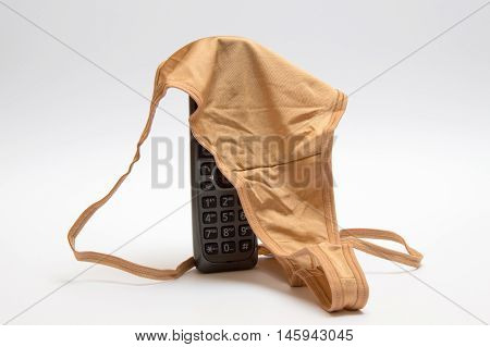 Concept of Stalking. Telephone with panties for women
