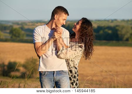 young couple posing high on country outdoor, romantic people love concept, summer season