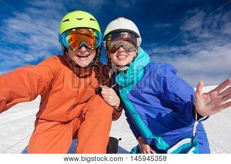 skiing and snowboarding. winter mountain vacation concept