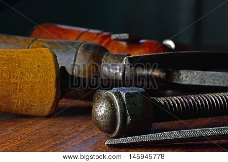 old tools worn by use over the worktable