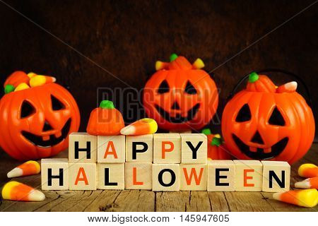 Happy Halloween Wooden Blocks With Candy Corn And Jack O Lantern Holders On An Orange And Black Back