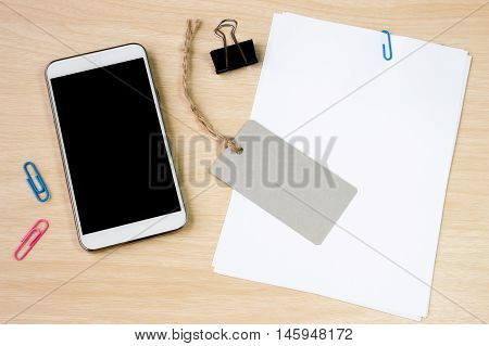 paper blank and paper note, color pencil, calculator, smartphone, pen on white desk with copyspace / for your text or message, artwork / view from above, top view / business, office equipment concept