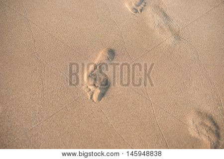 Footprints In The Sand. A Row Of Footprints In The Sand On A Beach In The Summertime. Summer Vacatio