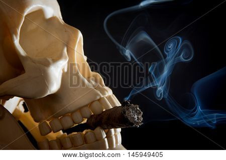 A human skull smoking a cigar on a black background