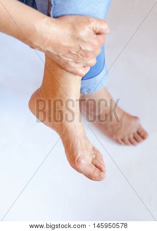 a painful swelling on the first joint of the big toe
