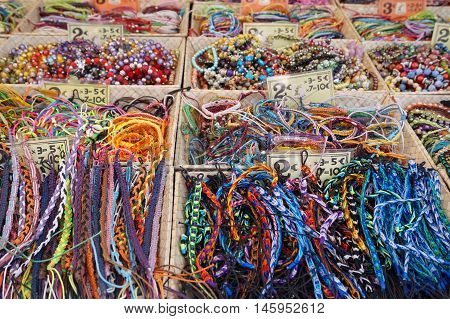 St Aygulf, Var, Provence, France, August 26 2016: Provencal Market Stall Selling Beads, Armbands And