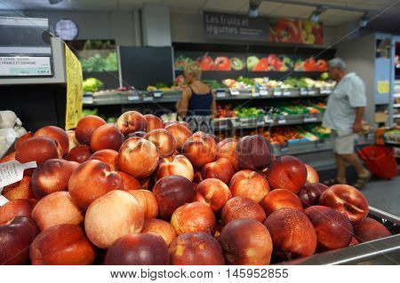 St Aygulf, Var, Provence, France, August 26 2016: A Pile Of Tasty Fresh Peaches With Customers Buyin