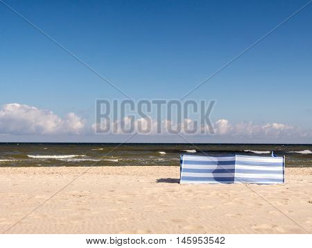 White and blue striped windbreak at the beach