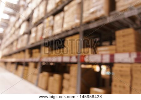 Close up De focused warehouse with multi-layer shelves