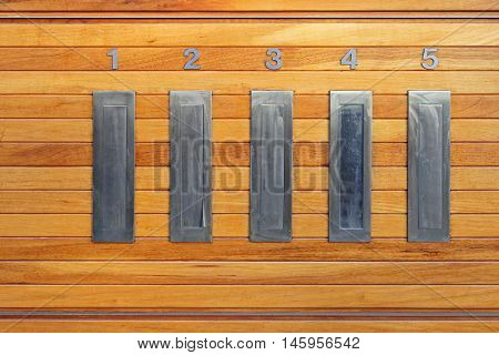 Letterbox Slots in Building Interior at Wooden Wall