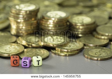 Gst Text And Gold Coins