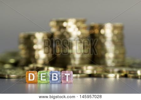 Debt Text And Gold Coin