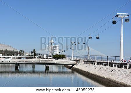 LISBON, PORTUGAL - AUG 21: Telecabine Lisboa at Parque das Nacoes (Park of Nations) in Lisbon, Portugal, as seen on Aug 21, 2016. The cable cars overlook the Vasco da Gama bridge on the Tagus river.