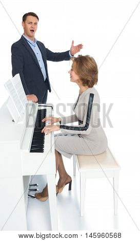 Young singer from the Opera. He was accompanied on piano by a young, beautiful pianist - Isolated on white background