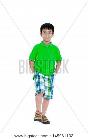 Full body of happy asian child in leather shoes smiling and looking at camera. Stylish boy having fun and walking at studio. Isolated on white background. Studio shot. Positive human emotion.
