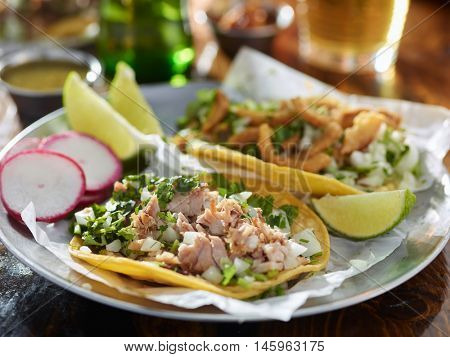 tasty tacos in yellow tortilla with chopped pork