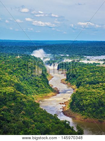 The Iguazu Falls on the Brazilian-Argentine border. Waterfalls are located in the two national parks - Argentina and Brazil in the dense tropical forests. Picture taken from a helicopter