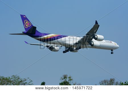 CHIANGMAI , THAILAND - MARCH 31 2009: HS-TNC Airbus A340-600 of Thaiairway. Landing to Chiangmai airport from Bangkok Suvarnabhumi.