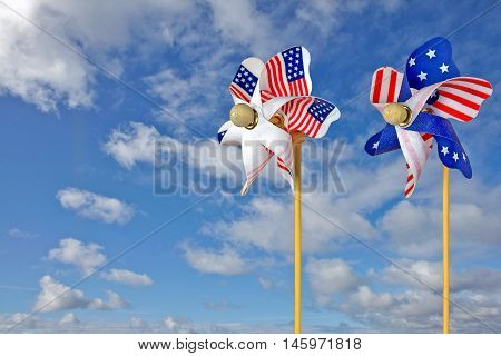 pair of patriotic pinwheels with summer sky background