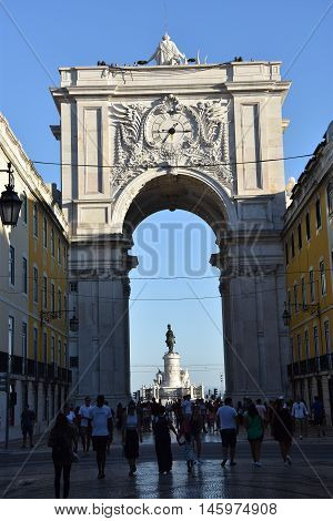 LISBON, PORTUGAL - AUG 21: Rua Augusta Arch in Praca do Comercio in Lisbon, Portugal, as seen on Aug 21, 2016. It was built to commemorate the city's reconstruction after the 1755 earthquake.