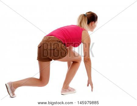 side view woman start position. Isolated over white background. Sport blond in brown shorts in the starting position