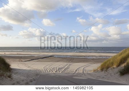 almost deserted beach with blue sky and clouds on the dutch island of vlieland
