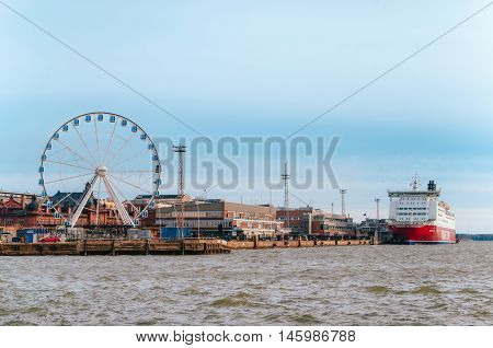 HELSINKI FINLAND - MARCH 17 2015: Panorama Of Katajanokka in Helsinki with Ferris wheel port and cruise ferry Finland