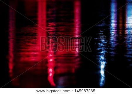 Light multicolored lights on the ground in raining day