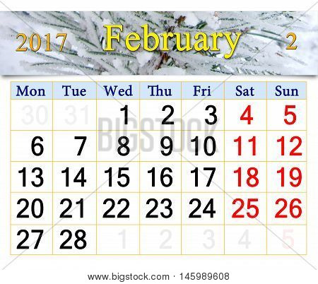 calendar for February 2017 with winter pines
