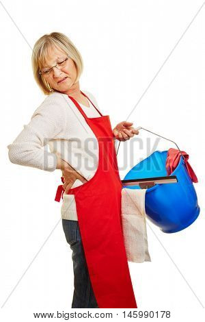Cleaning lady with chronic back pain carrying cleaning supplies