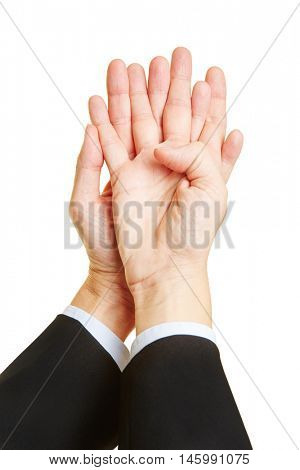 Man showing his two hands with crossed fingers